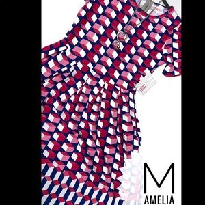 Size XS pink/red/blue geo print w/pockets